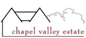 Logo of a bed and breakfast featuring line drawing of a home with red text